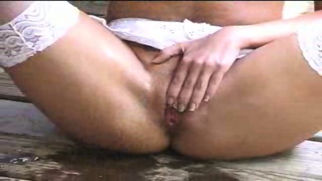 Slut pissing in front of People
