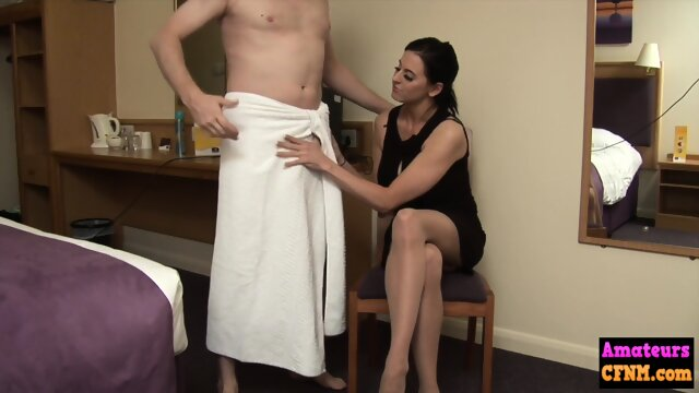 Hotel babe gives a femdom handjob