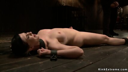 Brunette is chained in backbend position