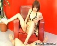 Shaved Asian In Lingerie Giving Footjob - scene 12