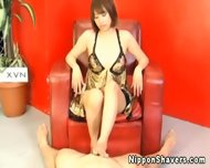 Shaved Asian In Lingerie Giving Footjob - scene 2