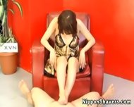 Shaved Asian In Lingerie Giving Footjob - scene 5