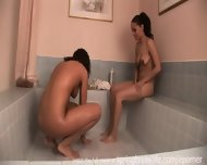 2 Girls Playing In A Tub - scene 5