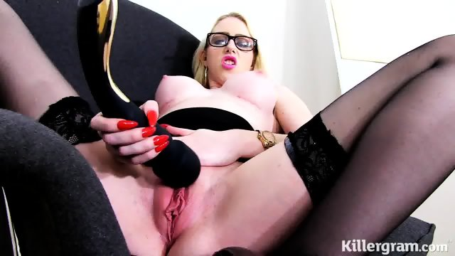 Vulgar Bitch With Glasses Plays With Dildo