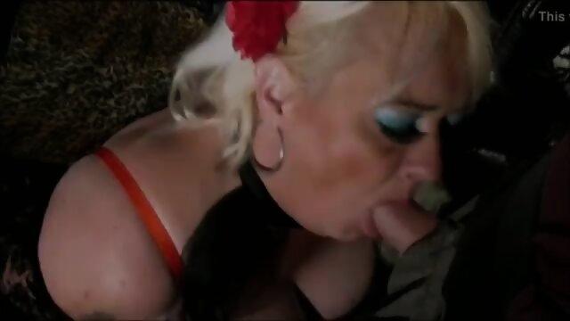 Handcuffed blonde sucks cock