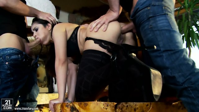 Hot Brunette Takes Care Of Two Dicks
