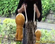 Asian Pee Slut Urinates - scene 12