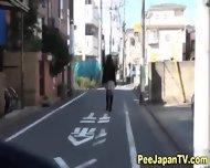 Asian Pisses Behind Car - scene 10