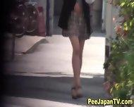 Asian Babe Caught Pissing - scene 4