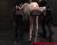 Blonde Sub Restrained In Stocks - scene 8
