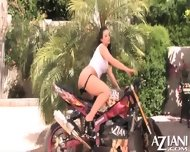 Aria Giovanni Does A Sexy Striptease By A Motorcycle And Rubs Her Naked Body - scene 8