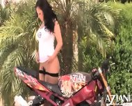 Aria Giovanni Does A Sexy Striptease By A Motorcycle And Rubs Her Naked Body - scene 10