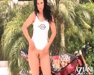 Aria Giovanni Does A Sexy Striptease By A Motorcycle And Rubs Her Naked Body - scene 11