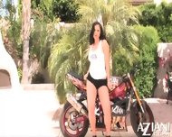 Aria Giovanni Does A Sexy Striptease By A Motorcycle And Rubs Her Naked Body - scene 2