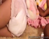 2 Beautiful Schoohirls Wearing Diapers Play Together - scene 1