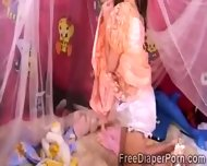 2 Beautiful Schoohirls Wearing Diapers Play Together - scene 5