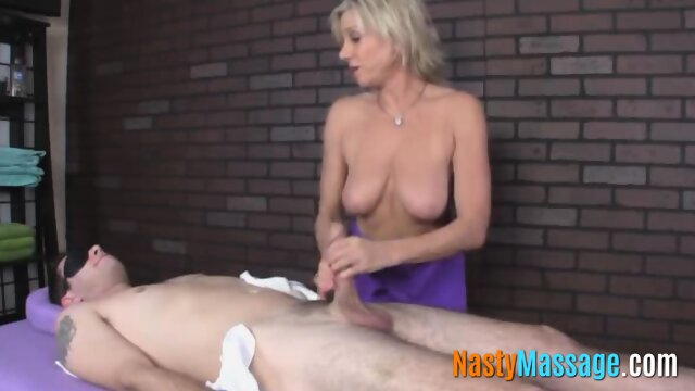 Kinky masseuse ties a guy and wanks his cock