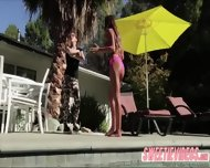 August And Pennys Scissor Sex In The Poolside - scene 1