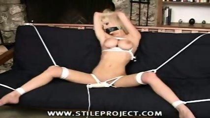 Bondage Girl struggles in her Restraints