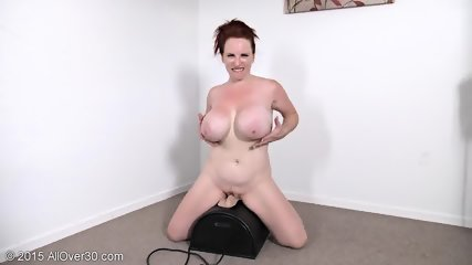 Mature Redhead Plays With Toys