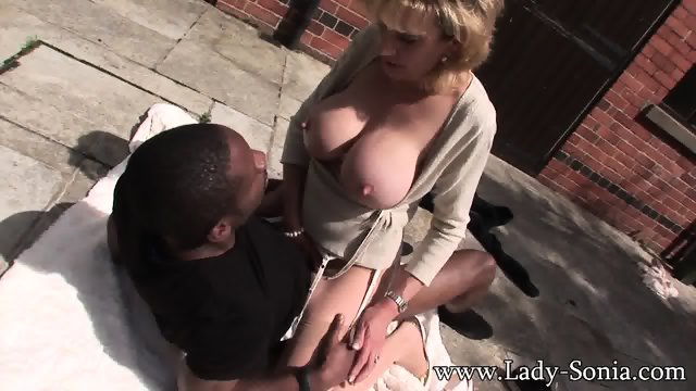 Mature Lady Rides Black Cock On The Pavement