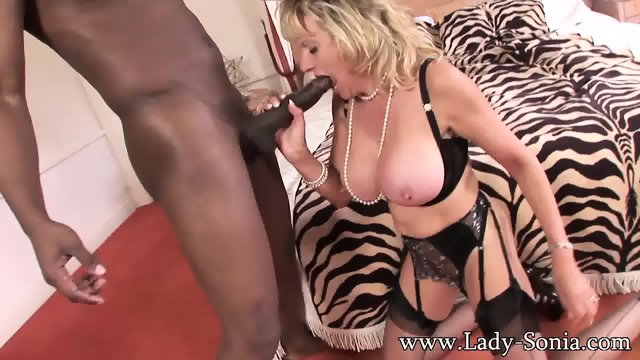 Mature Blonde Serves Big Black Pole
