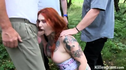 Tattooed Redhead Sucks Cocks In Forest - scene 4