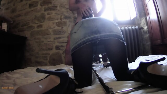 Tied to a machine, masked and hooded, she has to suck a big cock