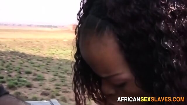African slut banged doggystyle against car