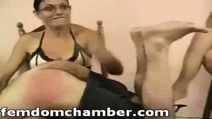 Two women spanking a man - scene 12