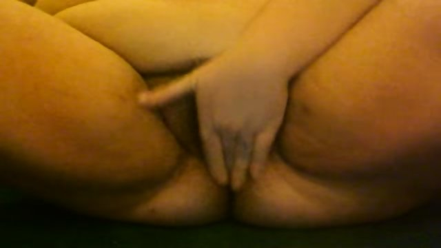 BBW filming herself rubbing her hairy pussy