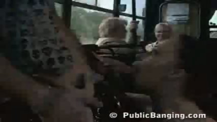 Sexy babe does a blowjob in a filled bus - scene 10