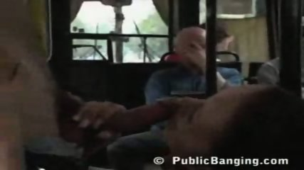 Sexy babe does a blowjob in a filled bus - scene 7