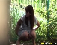 asian slut pees outside