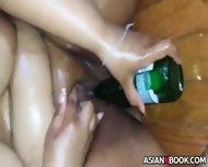 Chubby Asian Babe Inserts Bottle