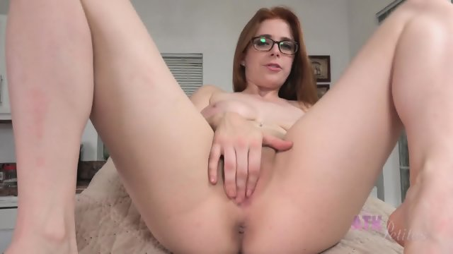 Redhead With Glasses Rubs Vagina