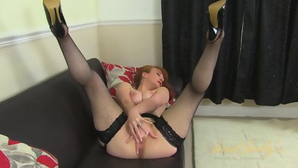 Mature Redhead Takes Off Clothes And Rubs Cunt