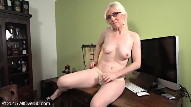Mature Blonde In Solo On Desk