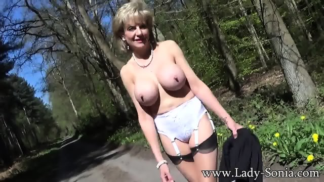 Mature Lady Shows Tits In The Forest