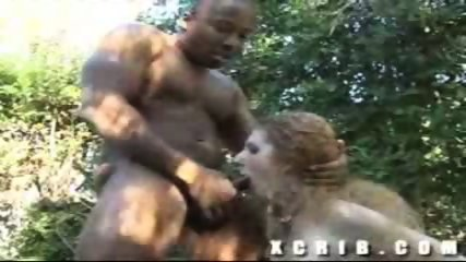 Curly blonde chick gets ass rammed by a black cock in the garden - scene 8