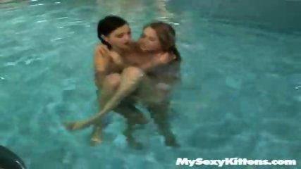 Lesbian Kittens having fun at the pool - scene 3