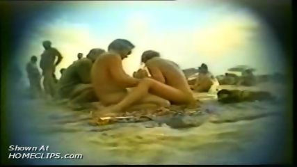 Hiddem cam at nudist beach - scene 11