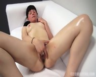 Amateur Oiled Girl Plays With Cunt
