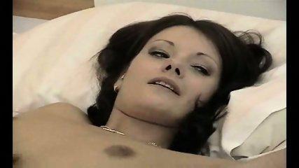 attractive brunette frigs herself for the camera - scene 1