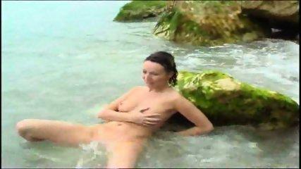 Ava disrobes on the beach - scene 12