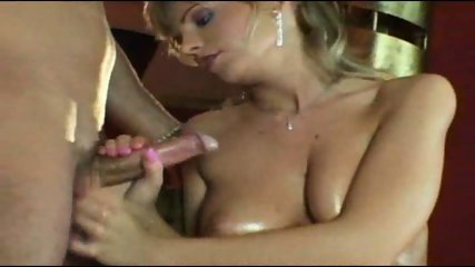 very attractive MILF gives a great handjob