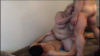 Chubby girl takes on two studs - scene 9
