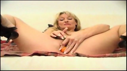 sexy blonde shoves an orange in her ass - scene 10
