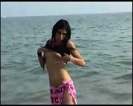 Stripping in the Surf - scene 3