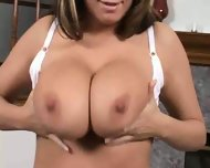 Big Hooters in a large white bra - scene 1